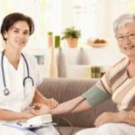 Home health care nurse and patient
